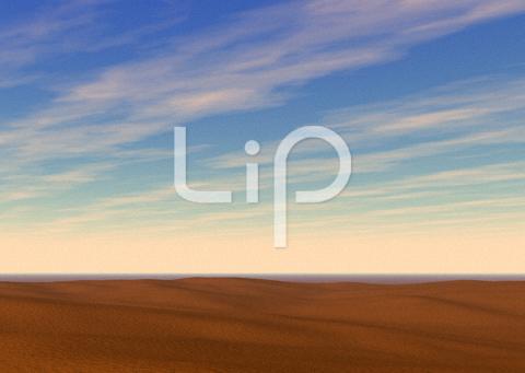 砂漠と明るい空と流れる雲