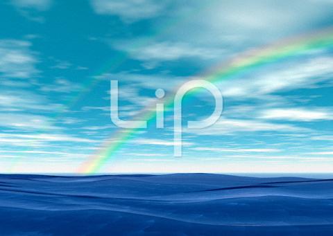 荒波と明るい空と虹
